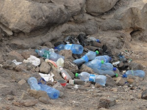 Used plastic bottles dumped on the ground at Erta Ale