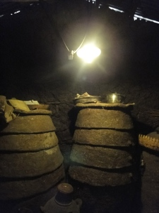 Biogas lamp lighting up the grain storage containers inside a rural house